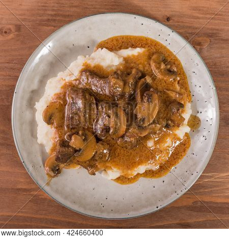 Plate With A Serving Of Homemade Mashed Potatoes And Beef Stroganoff In Beef And Mushrooms With Sauc