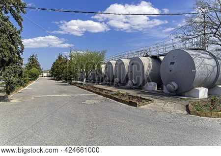 Sudak, Crimea - April 24, 2021: Tanks For Raw Wine Materials. Winery