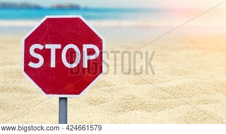 Lockdown Concept. Stop Sign On The Beach By The Sea. Ban On The Sea, Beaches, Recreation And Vacatio