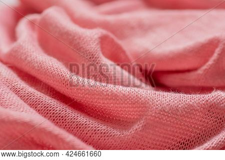 Pink Knitted Synthetic Fabric Texture Background. Close-up Of Folds In Fabric, Knit Texture, Weave,
