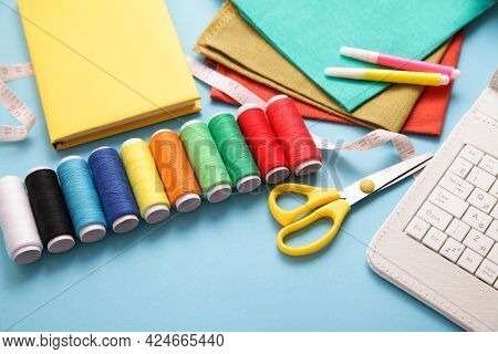 Online Sewing Courses For Kids. Sewing Background. Tools For Sew, Multicolor Threads, White Keyboard