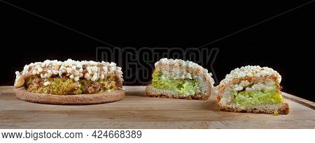 Delicious Pastries With Pistachio Curd And Nuts On A Wooden Board.
