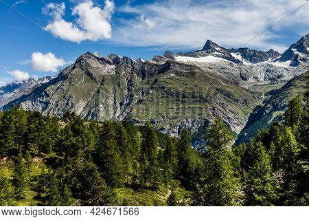 Mountain Panorama In The Swiss Alps, Cloudy Sky.