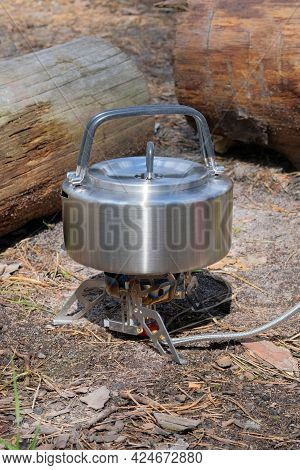 Metal Teapot On A Forest Background. Tourist Food For Outdoor Activities. Enjoy A Tasty Food During