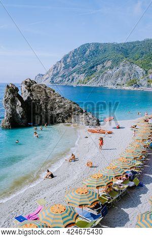 Cinque Terre Italy Monterosso September 2018, Chairs And Umbrellas Fill The Spiaggia Di Fegina Beach
