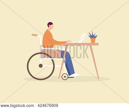 Disabled Young Man In A Wheelchair Working At A Computer In Home Office. Disabled Person Employment,