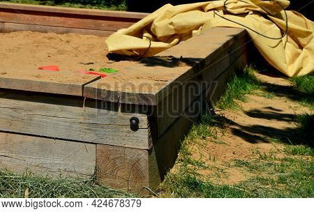 The Wooden Sandpit For Children Is Equipped With Handles For Covering The Sand With A Tarpaulin. Tra