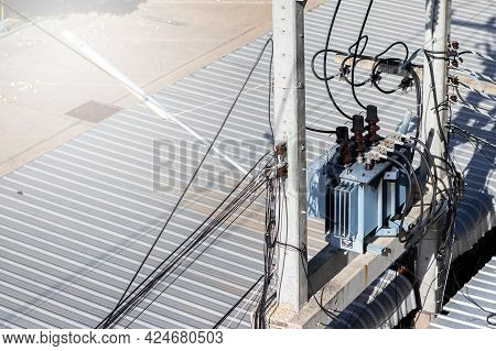 Electric Substation With Powerful Equipment And Transformers Working In City. Power Poles In Substat