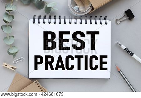 Best Practice. Text On White Paper On Gray Background