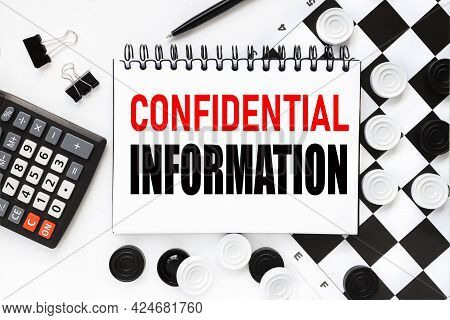 Confidential Information. Notepad On A White Background Near The Chessboard, Checkers Of White And B