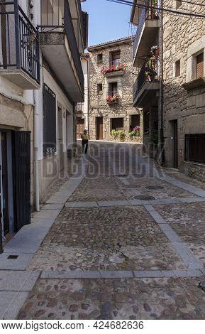 Acebo, Beautiful Little Town In Sierra De Gata, Caceres, Extremadura, Spain. Elder Man Walking Down