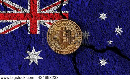 Bitcoin Crypto Currency Coin With Cracked Australia Flag. Crypto Restrictions