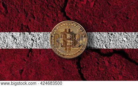 Bitcoin Crypto Currency Coin With Cracked Latvia Flag. Crypto Restrictions
