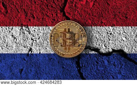 Bitcoin Crypto Currency Coin With Cracked Netherlands Flag. Crypto Restrictions