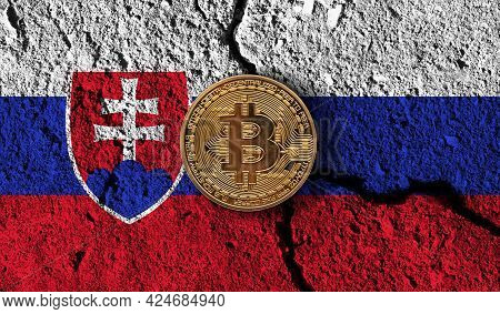 Bitcoin Crypto Currency Coin With Cracked Slovakia Flag. Crypto Restrictions