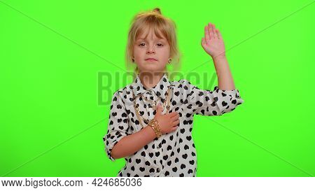 I Swear To Be Honest. Responsible Sincere Little Kid Child In Shirt Raising Hand To Take Oath, Promi