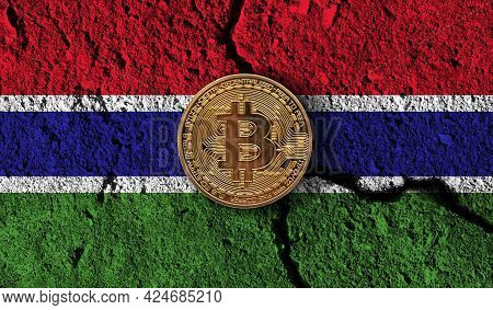 Bitcoin Crypto Currency Coin With Cracked Gambia Flag. Crypto Restrictions