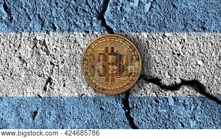 Bitcoin Crypto Currency Coin With Cracked Argentina Flag. Crypto Restrictions