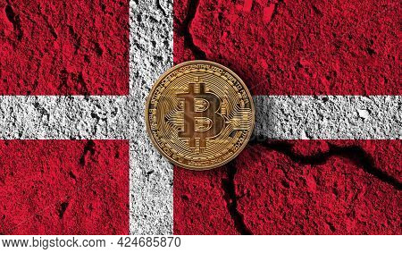 Bitcoin Crypto Currency Coin With Cracked Denmark Flag. Crypto Restrictions