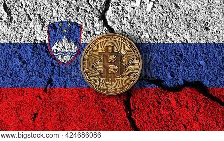 Bitcoin Crypto Currency Coin With Cracked Slovenia Flag. Crypto Restrictions