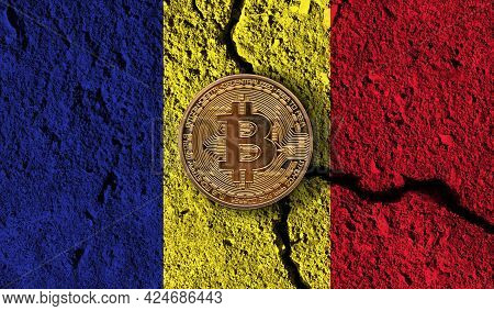 Bitcoin Crypto Currency Coin With Cracked Romania Flag. Crypto Restrictions