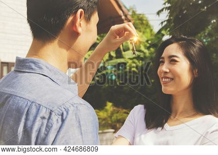 Family Planning With A New Home : Surprise Asian Couple Husband Presents House Keys To Beautiful Wif