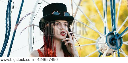 Glamorous Girl With Scarlet Dreadlocks And Cigarette