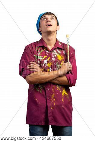 Smiling Young Painter Artist Holding Paintbrush. Portrait Of Happy Decorator Looking Upwards Isolate