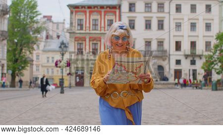 Elderly Tourist Stylish Grandmother Getting Lost In Big City Trying To Find Route. Senior Traveler G