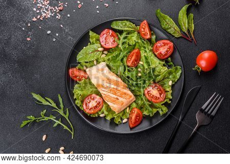 Delicious Fresh Salad With Fish, Tomatoes And Lettuce Leaves