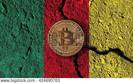 Bitcoin Crypto Currency Coin With Cracked Cameroon Flag. Crypto Restrictions