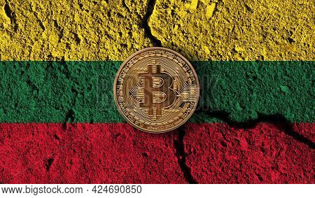 Bitcoin Crypto Currency Coin With Cracked Lithuania Flag. Crypto Restrictions