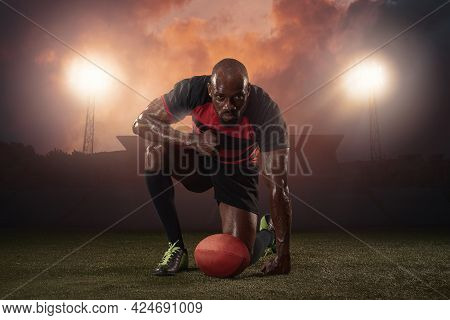 Professional Male Rugby Player Posing Isolated On Stadium Background. African Fit Athlete Preparing
