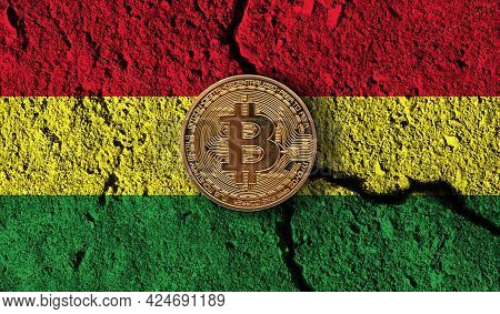 Bitcoin Crypto Currency Coin With Cracked Bolivia Flag. Crypto Restrictions