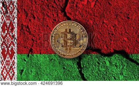 Bitcoin Crypto Currency Coin With Cracked Belarus Flag. Crypto Restrictions