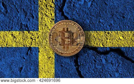 Bitcoin Crypto Currency Coin With Cracked Sweden Flag. Crypto Restrictions