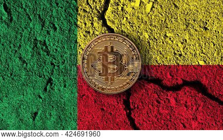 Bitcoin Crypto Currency Coin With Cracked Benin Flag. Crypto Restrictions