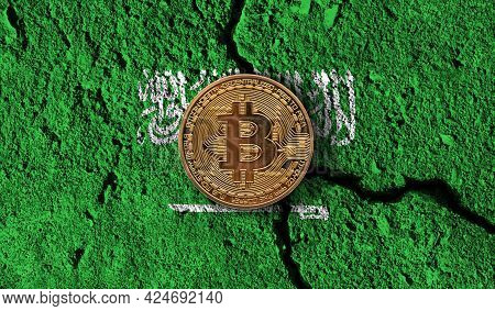 Bitcoin Crypto Currency Coin With Cracked Saudi Arabia Flag. Crypto Restrictions