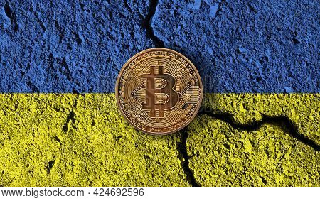 Bitcoin Crypto Currency Coin With Cracked Ukraine Flag. Crypto Restrictions