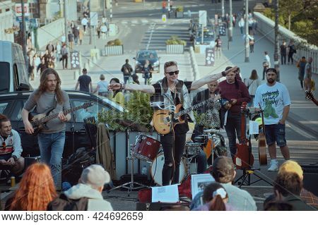 Princes Street. Edinburgh. Scotland. 2021-05-30. Street Musicians Playing With Guitars And Drums Sur
