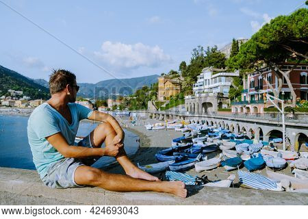Levanto Cinque Terre Colorful Village Italy, Colorful Beach With An Umbrella During The Summer Holid