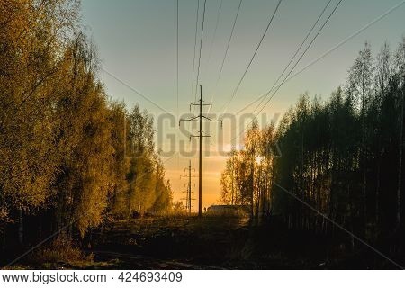 High-voltage Power Line In The Woods In Spring Against The Background Of The Evening Sky.