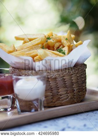 French Fries, Potato Chips Yellow Crispy Fries In Wooden Basket, Snack Delicious