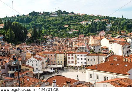 A Panoramic Of Old Town Piran, Slovenia. View Over The Tiled Roofs Of Piran And The Adriatic Sea.