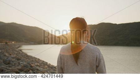 Woman enjoy sunset evening view at seaside