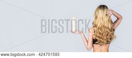 Woman Long Hair. Woman Hold Bottle Shampoo And Conditioner. Woman Holding Shampoo Bottle. Beautiful