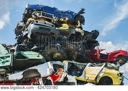 Pile Of Crushed Junk Cars On Scrapyard