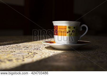 Coffe Cup On The Kitchen Table Shined By The Sun