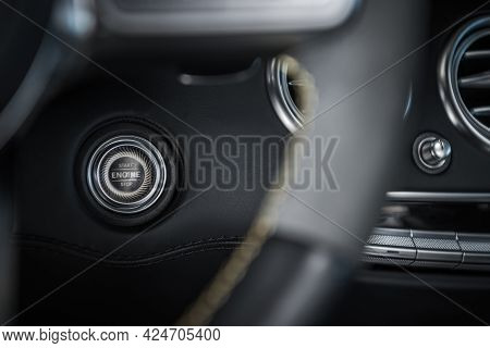 Elegant And Modern Start Stop Car Engine Ignition Button Close Up. Automotive Industry Theme.