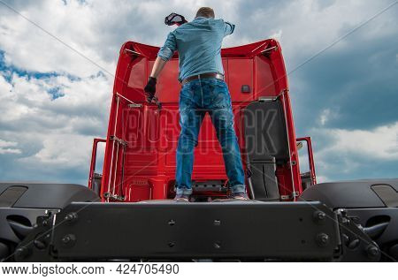 Sweating And Tired Caucasian Trucker In His 30s Staying On The Back Of His Truck Tractor Fifth Wheel